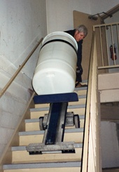 LW moving a drum down stairs