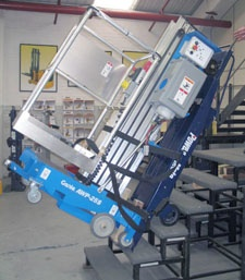 M-2B moves man lift up stairs!